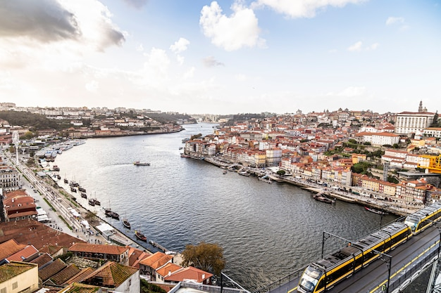 Douro river overlooking the lower city of porto in portugal. bridge with train Premium Photo