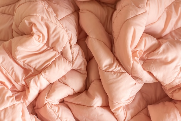 Down jacket fabric background, pink puffer jacket texture Premium Photo