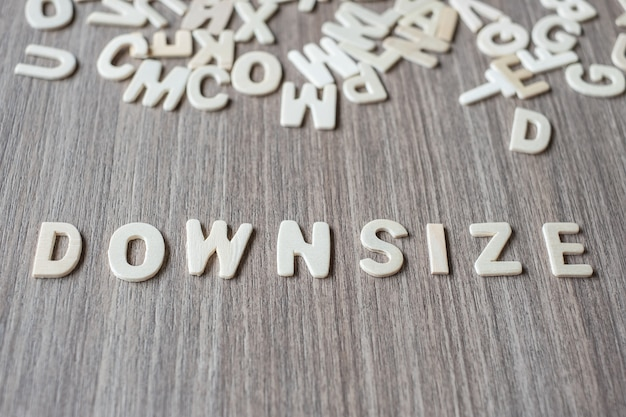 Downsize word of wooden alphabet letters. business and idea concept Premium Photo