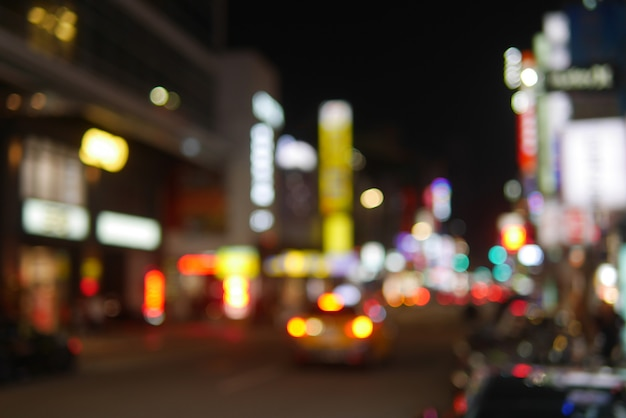 Downtown cityscape bokeh at night with light on in taiwan as tourism attraction Premium Photo