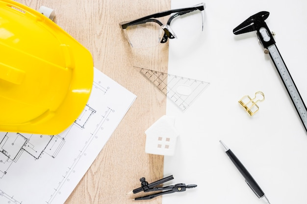 Drafting supplies around toy house Photo | Free Download