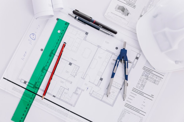 Drafting tools near plans and helmet Photo | Free Download