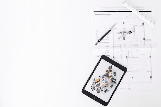Drafting tools near tablet and blueprints Photo | Free Download