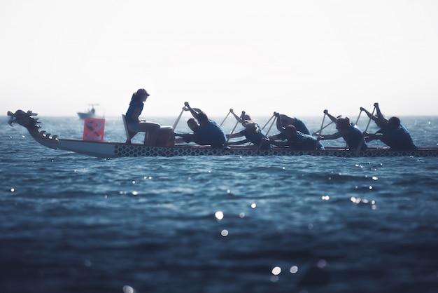 Dragon boat crew silhouette Premium Photo