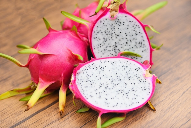 Dragon fruit slice on wooden background fresh pitaya summer tropical fruit . Premium Photo
