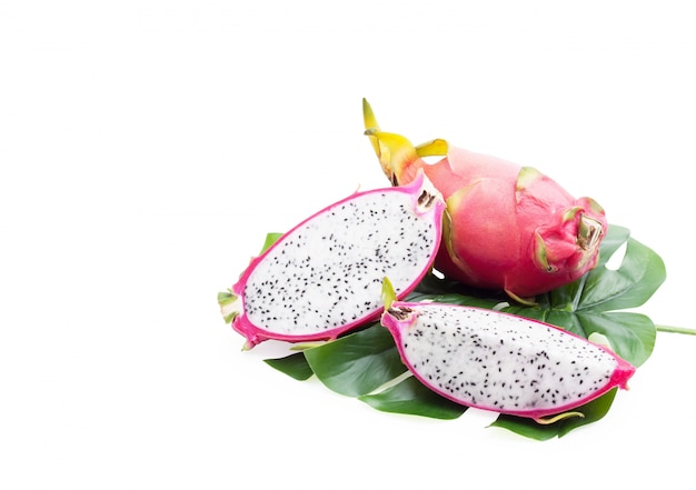 Dragon fruit tropical , healthy pitaya slice on green leaves isolated, Premium Photo