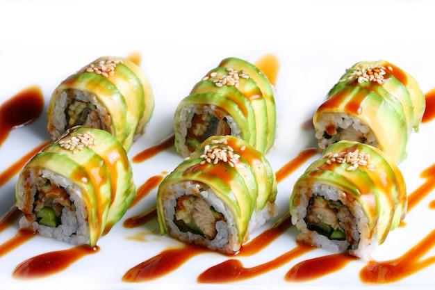 Dragon rolls sushi on white background Premium Photo