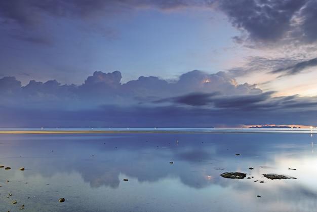 Dramatic rain cloud, sea and sky at dusk. long exposure technique Premium Photo