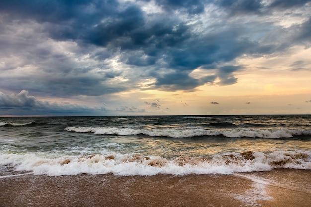 Dramatic sky on a morning seascape. storm on a sandy sea beach. Premium Photo