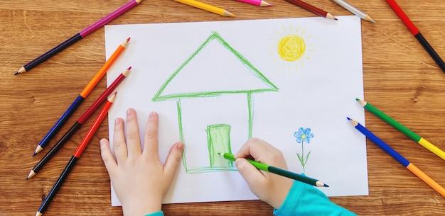 Draw child house family. selective focus. Premium Photo