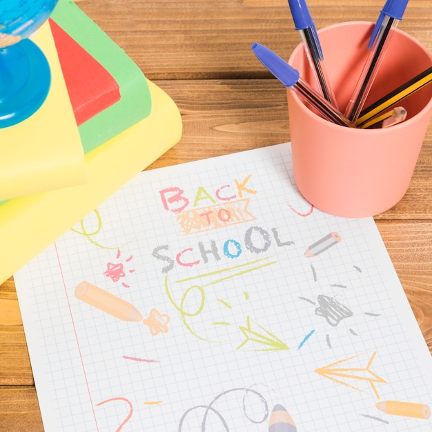 Drawing by colors on paper back to school on wooden table with books and pencils Free Photo