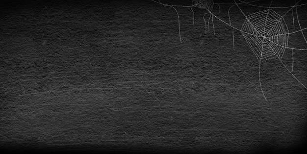 Drawing group of spider web at the corner on retro vintage chalkboard background for halloween night party Premium Photo