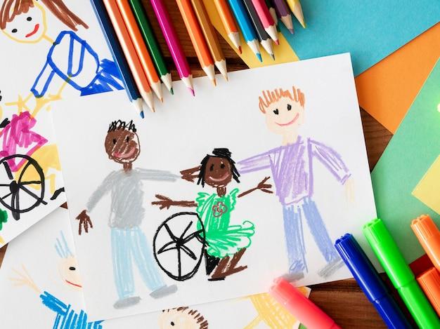 Рисунок ребенка-инвалида и друзей Premium Фотографии