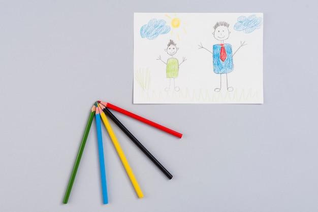 Рисунок отца и сына на бумаге Бесплатные Фотографии