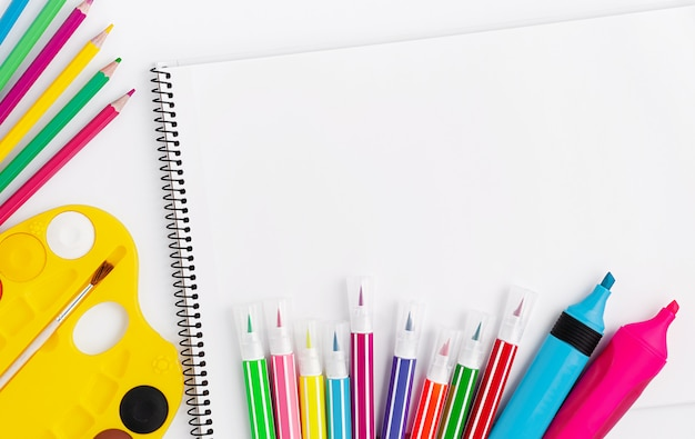 Drawing supplies and scetchbook on white background. top view, copy space Premium Photo