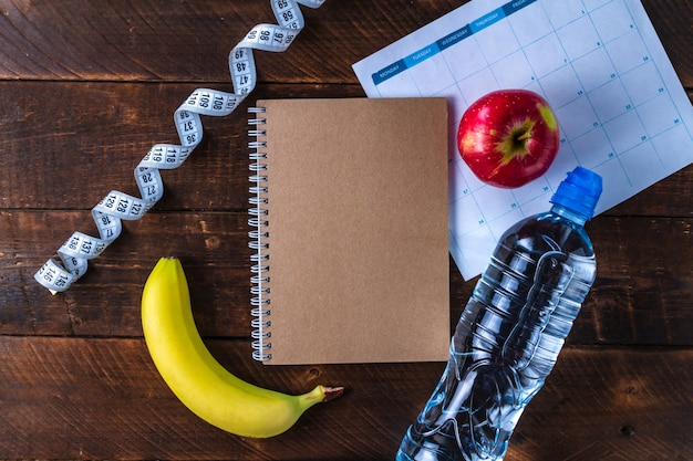 Drawing up and planning a program of sports training and diet. motivation. sport and diet concept. sports and healthy lifestyle. Premium Photo