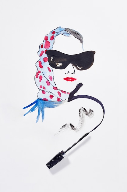 Drawing with make up products on paper. Premium Photo