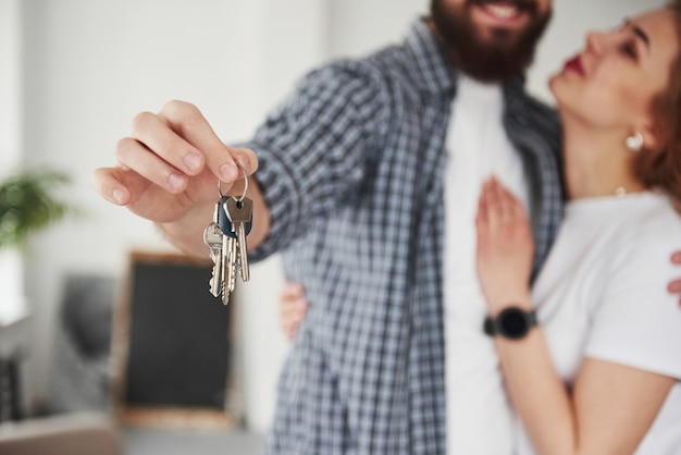 Dream come true. happy couple together in their new house. conception of moving Free Photo