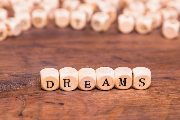 Dream word on wooden cubes Free Photo