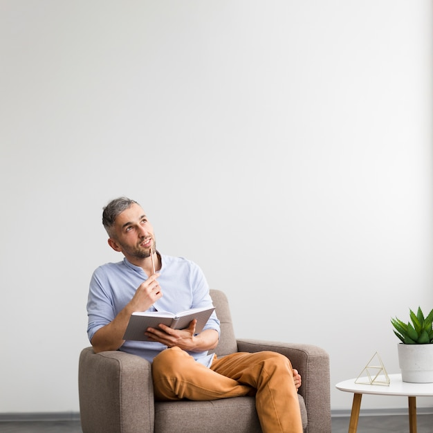 Dreamy man thinking about what to write Free Photo