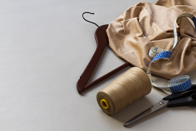 Dressmaker equipment with materials at workplace Free Photo