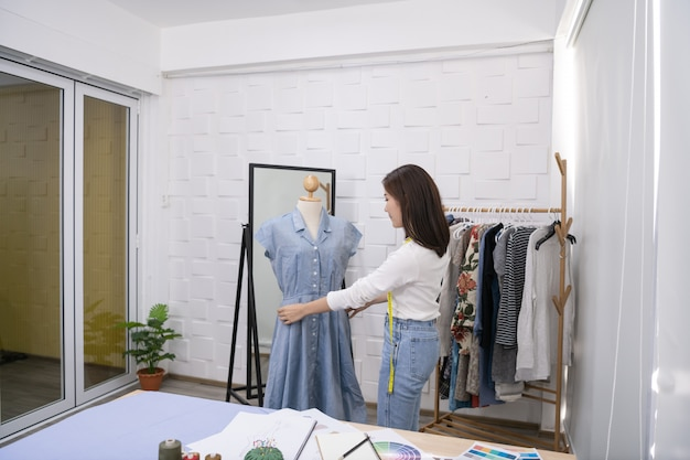 Dressmaker is designing an evening dress in the room. Premium Photo