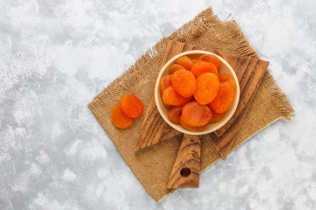 Dried apricots on light concrete Free Photo
