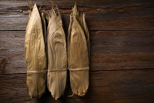 Dried bamboo leaves in brown for zongzi recipe Premium Photo