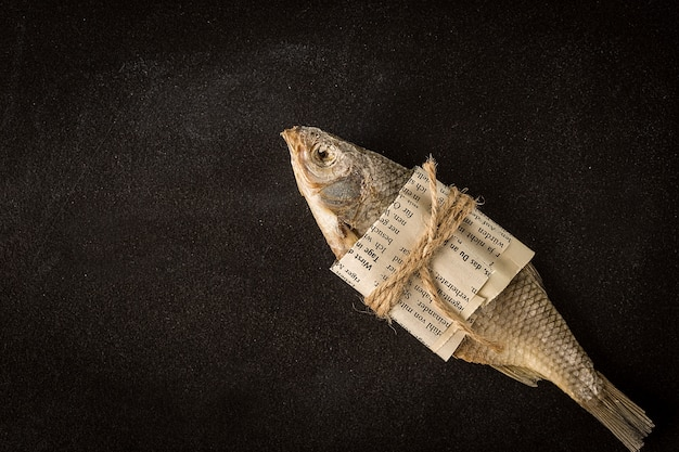 Dried fish on a dark. top view, flat lay. Premium Photo