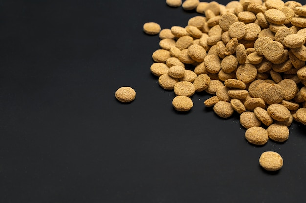 Dried food for dogs or cats. top view Premium Photo