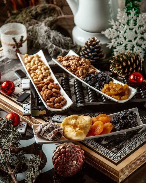 Dried fruits and nuts in plates Free Photo