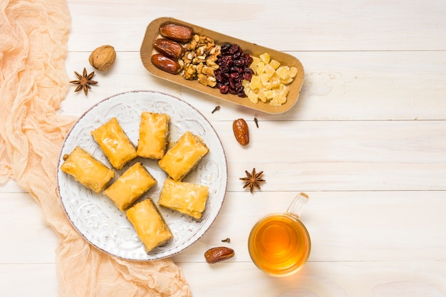 Dried fruits with eastern sweets and tea Free Photo