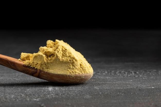 Premium Photo Dried Ground Mustard Powder In A Wooden Spoon