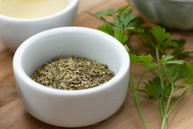 Sage Substitutes - Dried oregano leaves on small bowl