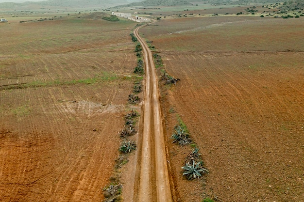 Dried plain with road taken by drone Free Photo