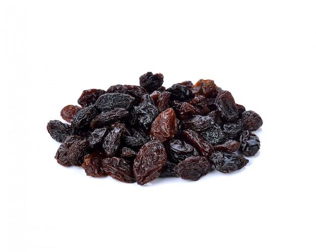 Dried raisins on white Premium Photo