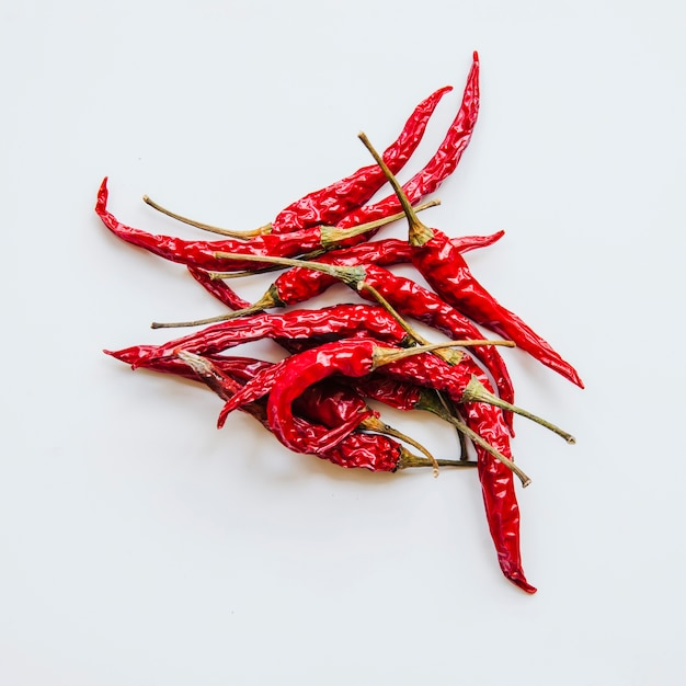 Dried red chilies on white background Free Photo
