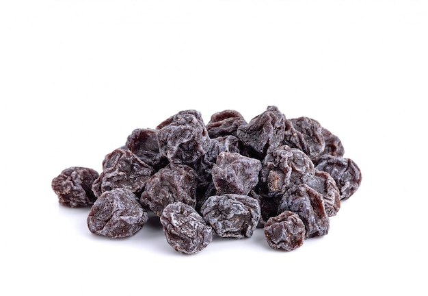 Dried sweet black plums isolated on white Premium Photo