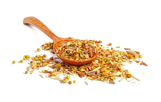Dried tea on a wooden spoon, isolated Premium Photo
