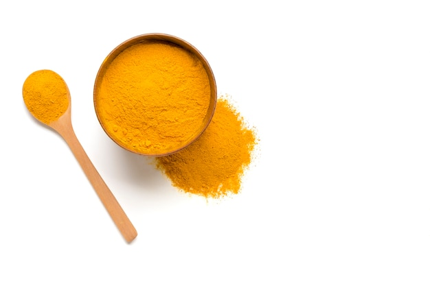 Dried turmeric, (curcumin),  yellow ginger powder isolated on white color background, Premium Photo