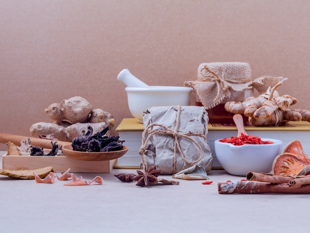 Dried various chinese herbs on old wooden background. Premium Photo