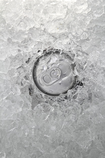Drink can iced submerged in frost ice closeup Premium Photo