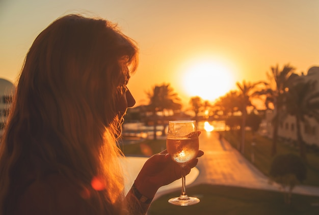 Drink wine by the sea Premium Photo