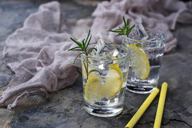 Drink with lemon and rosemary. selective focus Premium Photo