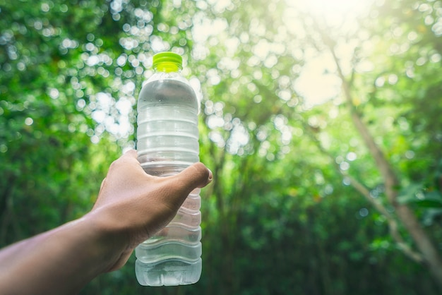 Drinking water and natural green Premium Photo