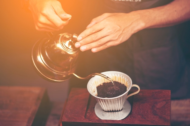 Drip brewing, filtered coffee, or pour-over is a method which involves pouring water over Premium Photo