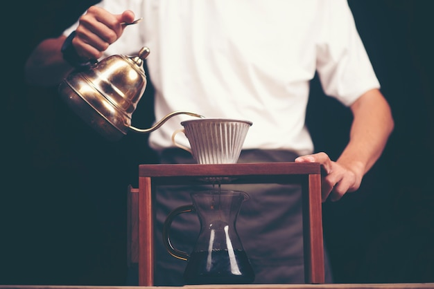 Drip brewing, filtered coffee, or pour-over is a method which involves pouring water Premium Photo