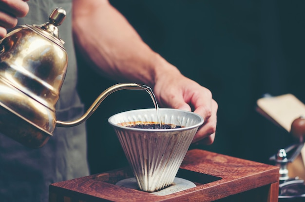 Drip coffee in cafe, vintage filter image Premium Photo
