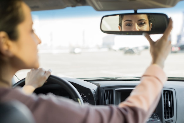 Driver adjusting the rear-view mirror Premium Photo