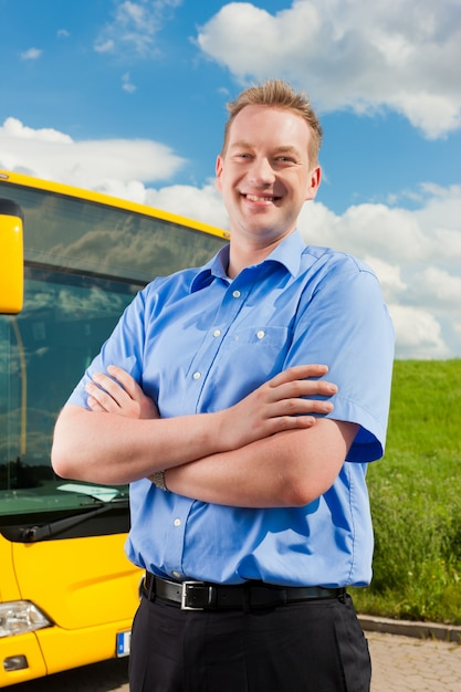 Driver in front of his bus Premium Photo